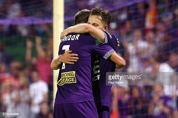 Gyorgy Sandor of the Glory congratulates Chris Harold after scoring the fourth goal during the round 23 ALeague match between the Perth Glory and the...