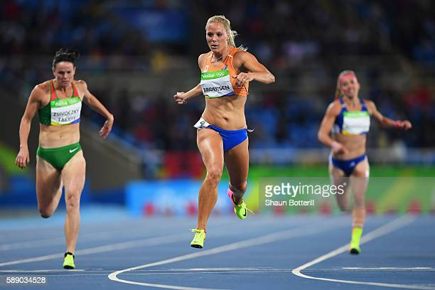 Gyorgyi ZsivoczkyFarkas of Hungary and Nadine Broersen of the Netherlands compete in the Women's Heptathlon 200 metres heats on Day 7 of the Rio 2016...