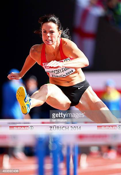 Gyorgyi ZsivoczkyFarkas of Hungary competes in the Women's Heptathlon 100 metres hurdles during day three of the 22nd European Athletics...