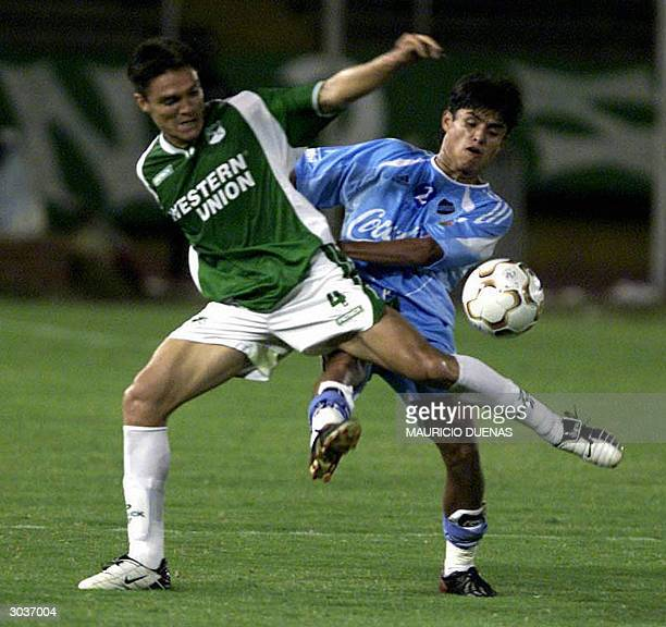 Gyovanny Garcia of Colombia's Deportivo Cali pursues Limber Pizarro of Bolivia's Bolivar during the first half of their football match in group 8 of...
