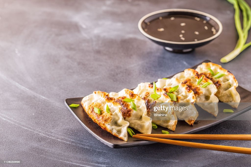 Gyoza or dumplings snack with soy sauce, selective focus : Stock Photo