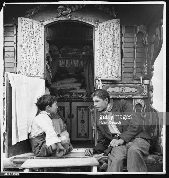 Gypsies Beside Their Caravan Few Romanies now live a life of wandering romance Most are like the three hundred squatters of Corke's Meadow Kent which...