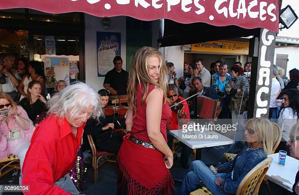 Gypsies dance in a cafe in Saintes Maries de la Mer in the Camargue region of Southern France on May 25 2004 The annual pilgrimage is observed by...