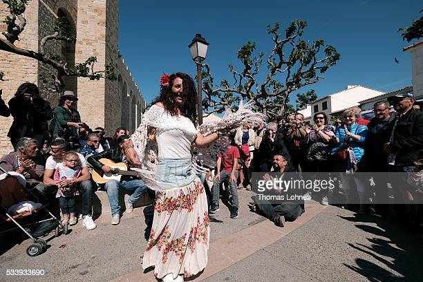 Gypsies dance in front of church to the traditional music of gitares on May 24 2016 in Staintes Maries de la Mere near Arles France Gypsies from all...