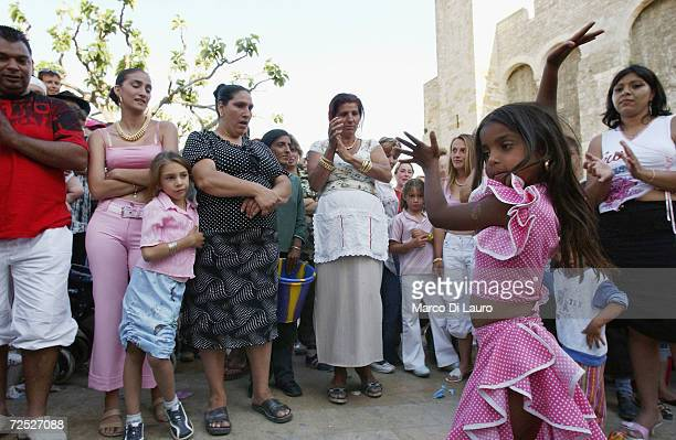 Gypsies dance in the street in Saintes Maries de la Mer in the Camargue region of Southern France on May 25 2004 The annual pilgrimage is observed by...
