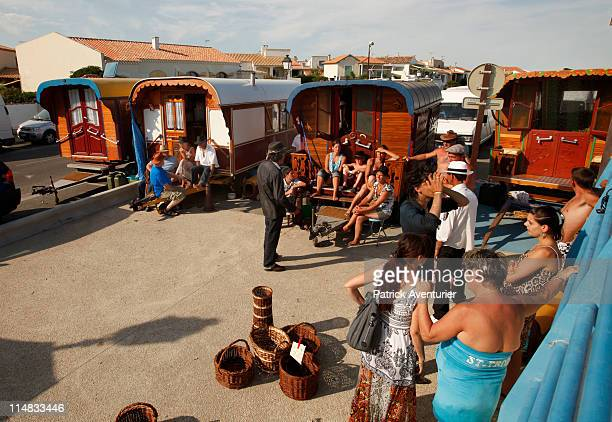 Gypsies in traditional Roulottes seen on May 24 2011 in Saintes Maries de la Mer France Roms Manouches Tziganes and other gypsies come from all over...