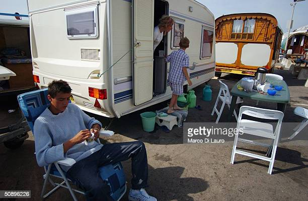 Gypsies relax in front of their caravans in Saintes Maries de la Mer in the Camargue region of Southern France on May 25 2004The annual pilgrimage is...