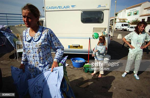 Gypsies stand in front of their caravans in Saintes Maries de la Mer in the Camargue region of Southern France on May 25 2004The annual pilgrimage is...