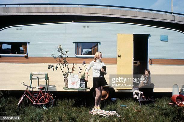 Gypsies travellers in their caravan under the Westway road London 1970's