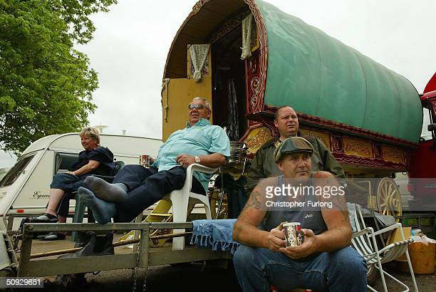 Gypsies watch the racing from a traditional romany caravan at Appleby Horse Fair June 5 2004 in Appleby England Appleby Horse Fair has existed under...