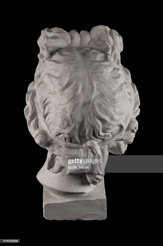 Gypsum statue of Apollo's head on a black background : Foto de stock