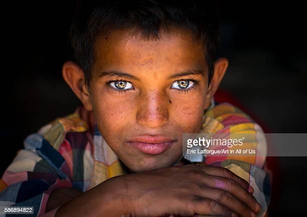 Gypsy boy with beautiful eyes central county kerman Iran on January 1 2016 in Kerman Iran