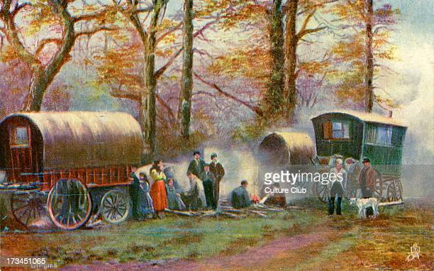 Gypsy camp in the countryside Shows gypsies gathered round a fire with caravans