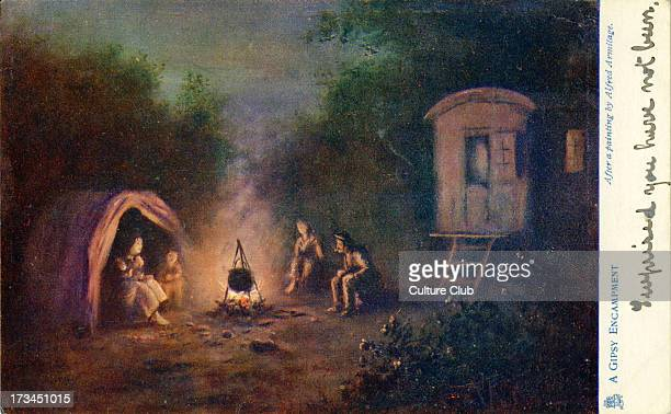A gypsy encampment Shows a family gathered round a fire their caravan and tent in the background After a painting by Alfred Armitage