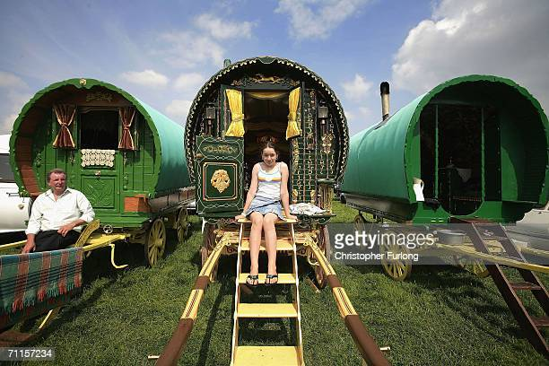 Gypsy families sit with their caravans as they attend the Appleby Horse Fair June 8 2006 in ApplebyinWestmorland England Appleby Horse Fair has...