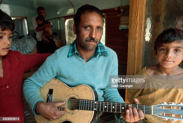 gypsy father playing guitar - grimes musician stock pictures, royalty-free photos & images