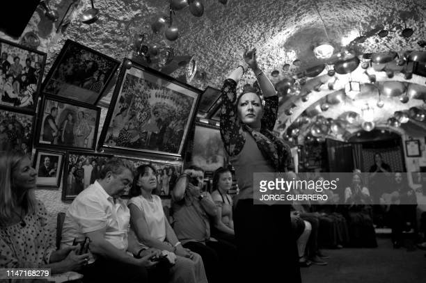 A gypsy flamenco dancer performs a Zambra dance for tourists in the Cueva Maria la Canastera at Sacromonte neighbourhood in Granada on May 30 2019...