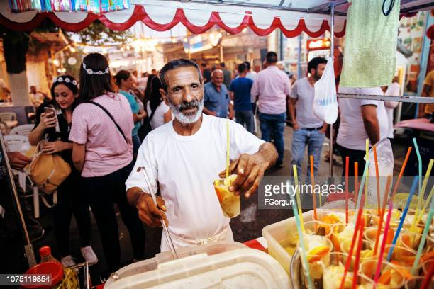 Gypsy man selling traditional Turkish pickles of various fruits and vegetables