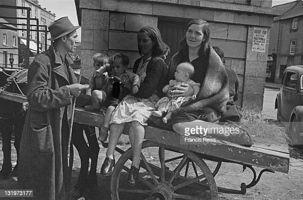 Gypsy mothers and their children sit on a cart in a Galway street Ireland 1945 Original Publication Picture Post 2082 Off To The Galway Races pub 1st...