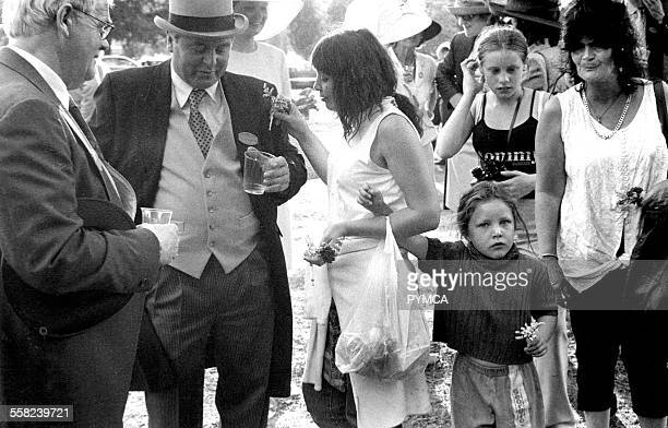 Gypsy woman and daughters selling lucky heather at Ascot horse races UK 1990s