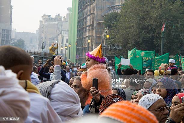 gyptian Sufi Muslims chant prayers while walking in a march with banners as they celebrate quotMawlid alNabawiquot or the birth of Prophet Mohammad...