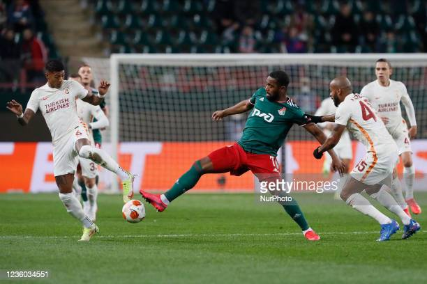 Gyrano Kerk of Lokomotiv Moscow vies for the ball with Patrick van Aanholt and Marcao of Galatasaray during the UEFA Europa League Group E football...