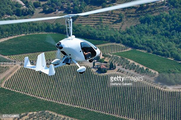 Gyrocopter flying in the country of Arezzo