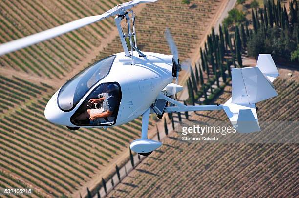 Gyrocopter flying in the country