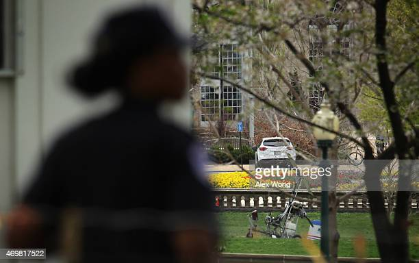 A gyrocopter sits on the West Lawn of the US Capitol with a member of the US Capitol Police nearby April 15 2015 in Washington DC Doug Hughes from...
