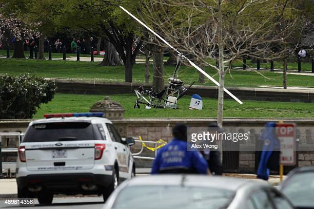 A gyrocopter sits on the West Lawn of the US Capitol with members of the US Capitol Police nearby April 15 2015 in Washington DC Doug Hughes from...