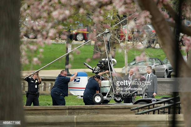 A gyrocopter that illegally landed on the West Front of the US Capitol is loaded onto a US Capitol Police trailer April 15 2015 in Washington DC Doug...