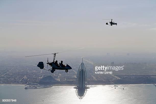 Gyrocopters fly over the Gulf Emirate of Dubai during the World Air Games 2015 on December 9 2015 AFP PHOTO / POOL / KARIM SAHIB / AFP / POOL / KARIM...
