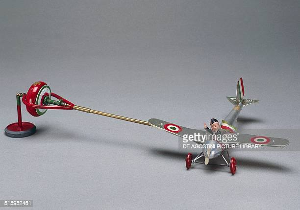Gyroscope with plane piloted by a Fascist Balilla boy scientific toy Italy 20th century Milan Museo Del Giocattolo E Del Bambino