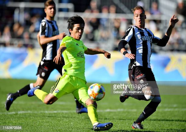 Gyuhyeong Kim of Dinamo Zagreb takes a shot as Apostolos Diamantis of PAOK FC tries to block in the third place playoff match between Dinamo Zagreb...