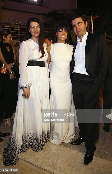 Gyunel Rustamova Michelle Rodriguez and Juma Ahmad Zada attend the De Grisogono Divine In Cannes Dinner Party at Hotel du CapEdenRoc on May 19 2015...