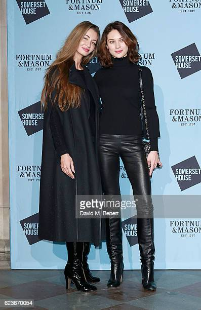 Gyunel Taylor and Olga Kurylenko attend the opening party of Skate at Somerset House with Fortnum Mason on November 16 2016 in London England...