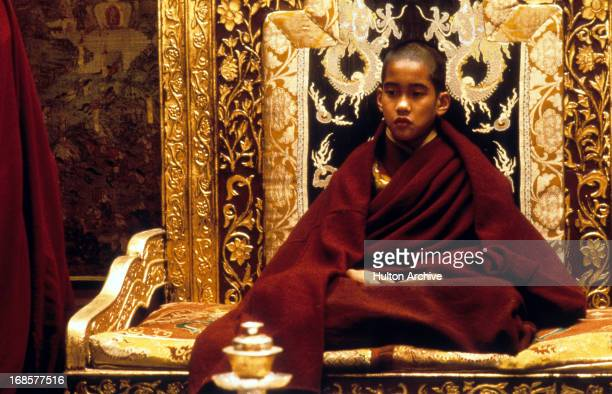 Gyurme Tethong on a throne in a scene from the film 'Kundun' 1997