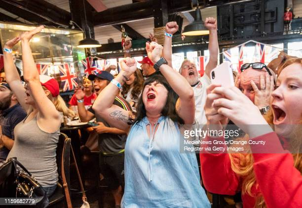 Gywn Tye, center, of Huntington Beach reacts while watching the U.S. Vs. England in the Women's World Cup semifinal match at The Olde Ship British...