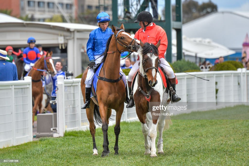 /h1/ ridden by /j1/ before the /r7/ at Caulfield Racecourse on October 01, 2017 in Caulfield, Australia.