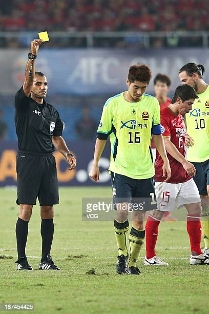 Ha DaeSung of FC Seoul is shown the yellow card by referee Nawaf Shukralla during the AFC Champions League Final 2nd leg match between Guangzhou...
