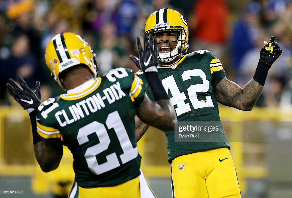 Ha Ha Clinton-Dix #21 and Morgan Burnett #42 of the Green Bay Packers celebrate after Burnett recorded a sack in the fourth quarter against the Indianapolis Colts at Lambeau Field on November 6, 2016 in Green Bay, Wisconsin.