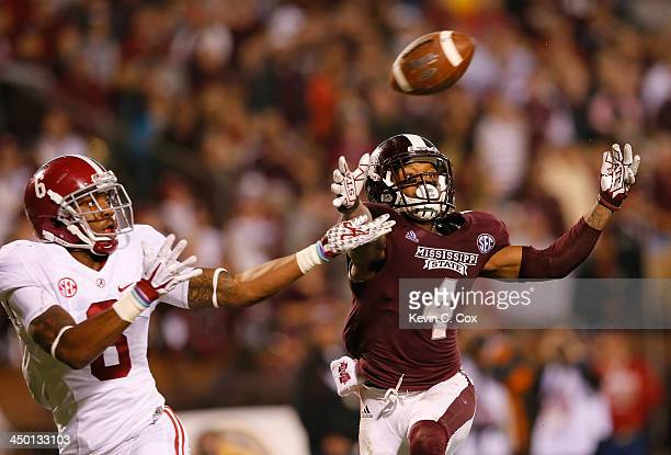 Ha Ha ClintonDix of the Alabama Crimson Tide intercepts a touchdown reception intended for Jameon Lewis of the Mississippi State Bulldogs at Davis...