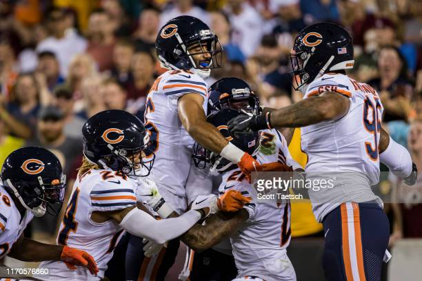 Ha Ha ClintonDix of the Chicago Bears celebrates with teammates after scoring a touchdown against the Washington Redskins during the first half at...