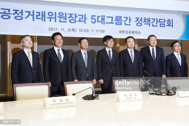 Ha Hyunhwoi chief executive officer of LG Corp from left Park Jungho president and chief executive officer of SK Telecom Co Lee Sanghoon president at...