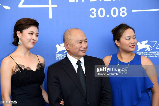 Ha Jiwon John Woo and Angeles Woo attend the 'Zhuibu ' photocall during the 74th Venice Film Festival on September 8 2017 in Venice Italy