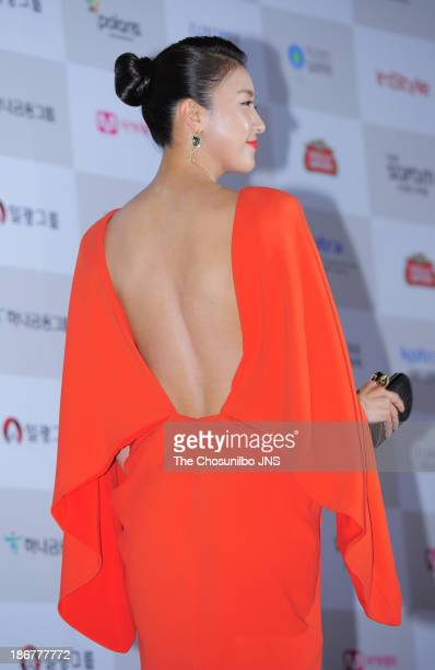 Ha JiWon poses for photographs upon arrival during the 50th Dae Jong Film Awards at KBS Hall on November 1 2013 in Seoul South Korea