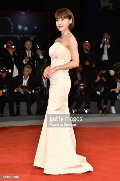 Ha JiWon walks the red carpet ahead of the 'Manhunt ' screening during the 74th Venice Film Festival at Sala Darsena on September 8 2017 in Venice...