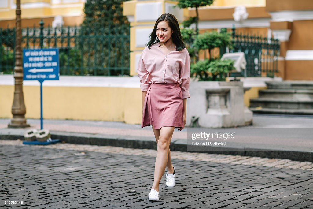 b65b16636 Ha Khanh Van is wearing a pink shirt, a pink skirt, and white shoes ...