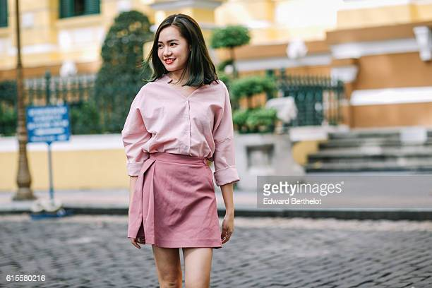 d64e71613 Ha Khanh Van is wearing a pink shirt a pink skirt and white shoes on October