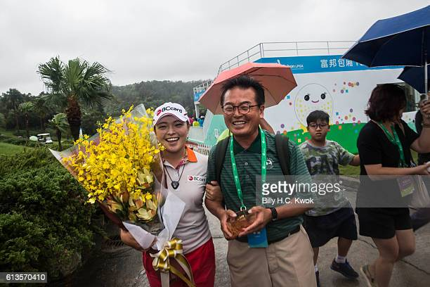 Ha Na Jang celebrates with her father after winning the competition in the Fubon Taiwan LPGA Championship on October 9 2016 in Taipei Taiwan